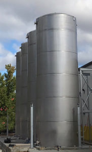Vertical Stainless Steel Silos in a Row